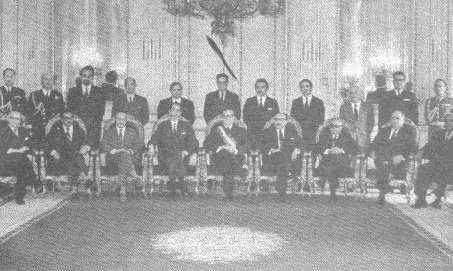 The first cabinet of the Popular Government. (Stand, from left to right.:) Jaime Suárez, Secretary of Government; Orlando Canturrias, Mining; Jacques Chonchol, Farming; José Oyarce, Work; Humberto Martones, Land and Colonization; Oscar Jiménez, Wealth; Carlos Cortés, Housing. (Sit, from left to right:)Alejadro Ríos, Defense; Mario Astroga, Education; Pedro Vuskovic, Economy; José Tohá, Interior; Clodomiro Almeyda, Foreign Affairs; Américo Zorrilla, Treasury; Lisandro Cruz, Justice and Pascual Barraza, Public Works.